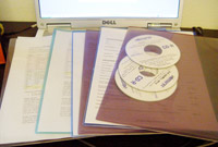 Plastic document sleeves hold project files.